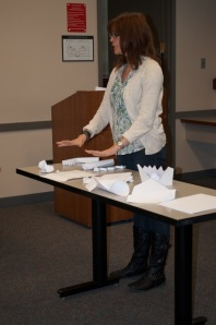 Participant describing her paper sculpture